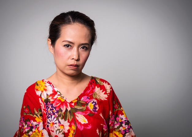 Asian adult woman straight face on white background.