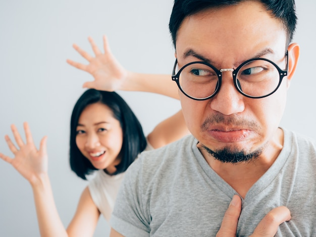 Asian angry and annoyed husband with happy and stubborn wife