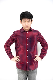 Asian angry boy on white background .