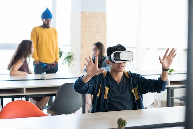 Asian app developer using virtual reality simulator