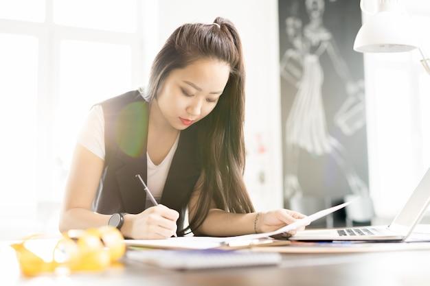 Asian artist working in design studio