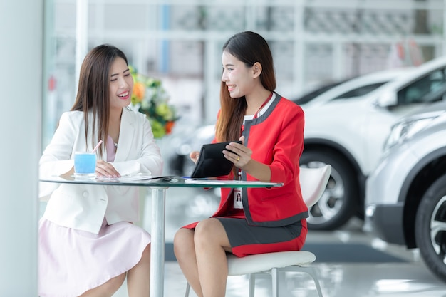 Asian auto business, car sale, technology and people concept - happy couple with car.