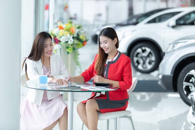 Asian auto business, car sale, technology and people concept - happy couple.