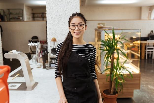 Asian barmaid in eyeglasses