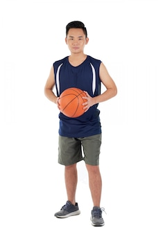Asian basketball player in activewear standing against white background