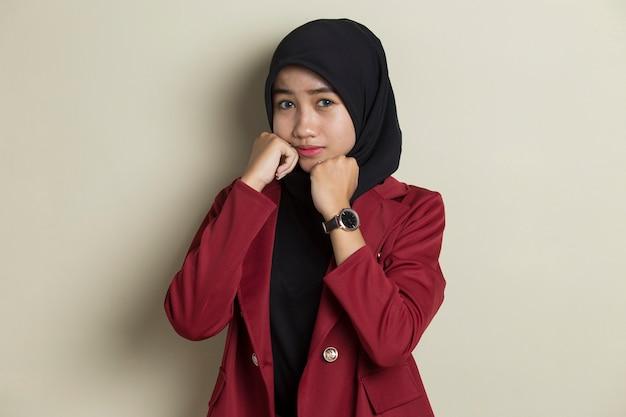 Asian beautiful muslim woman with elegant appearance thinking.