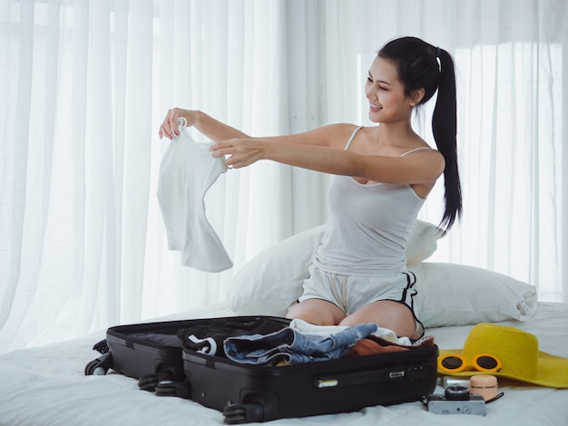 Asian beautiful woman are preparing bags to go on holiday