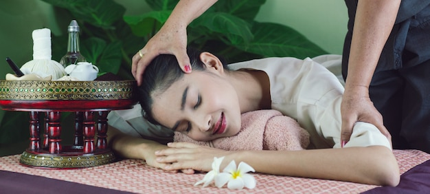 Asian beautiful woman get a massage and spa. specialists from massage
