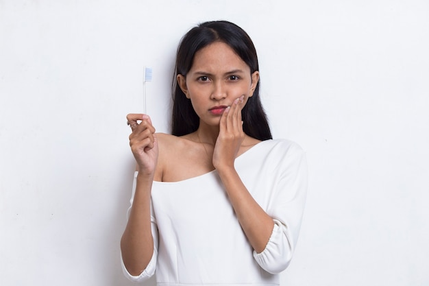 Asian beautiful young woman suffering from toothache pain tooth decay tooth sensitivity
