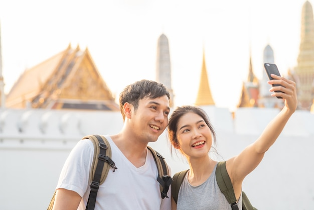 Asian blogger couple travel in bangkok, thailand
