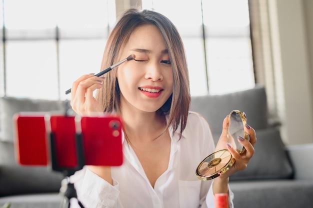 Asian blogger woman recording video makeup cosmetic