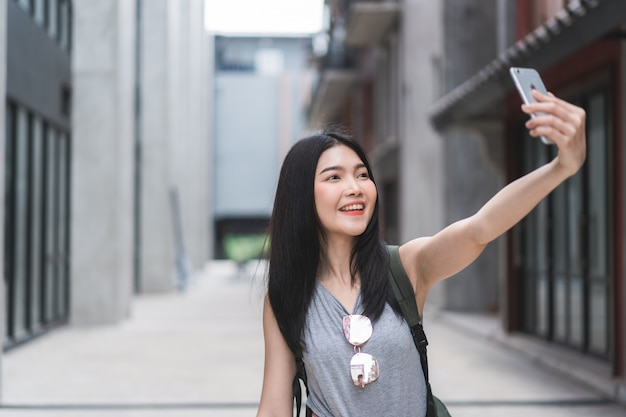 Asian blogger woman travel in beijing, china