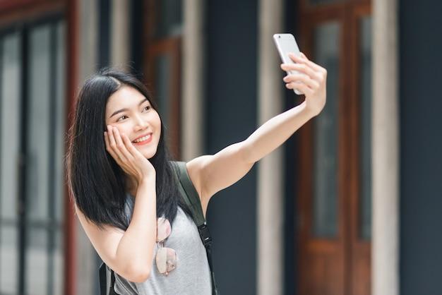 중국 베이징에서 아시아 블로거 여자 여행