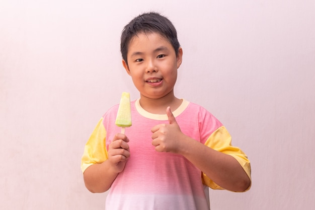 Asian boy eating a popsicle portrait