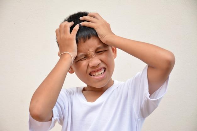 Asian boy headache
