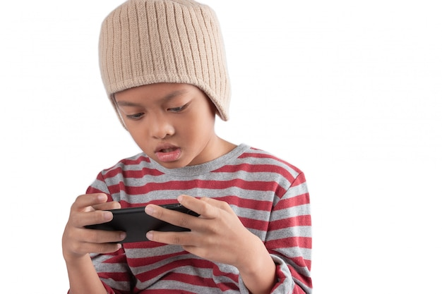 Asian boy is playing games on his smartphone isolated on white background.