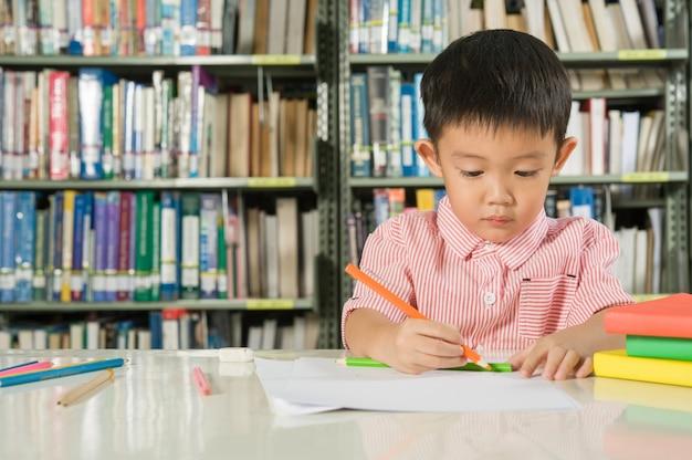 Asian boy in library room school