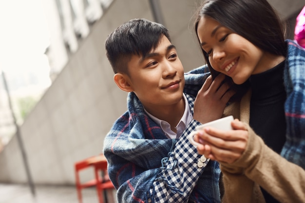 Asian boy taking care of attractive girlfriend.