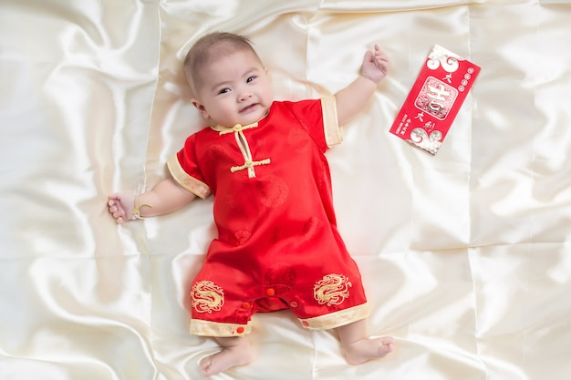 Asian  boy in traditional chinese suit on white background, chinese new year concept.
