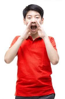 Asian boy wearing a red shirt shouting loudly