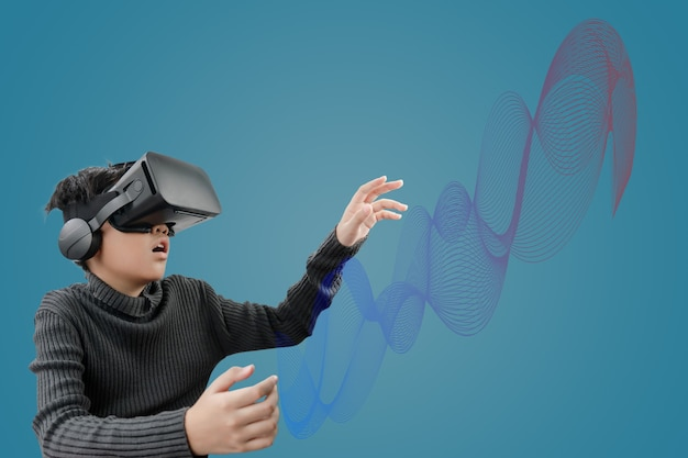 Asian boy wearing vr glasses headset with technology graphics in front on blue color background.
