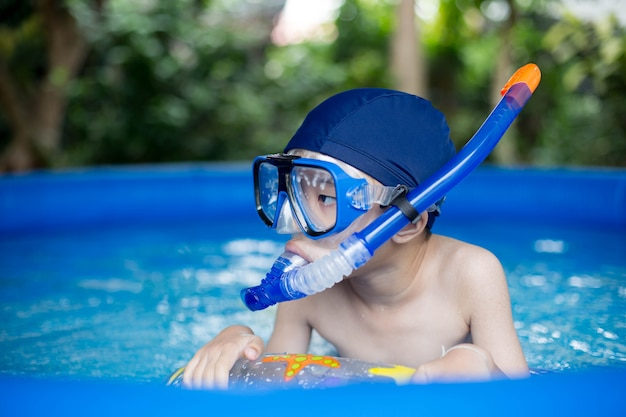 Asian boy with snorkel in pool