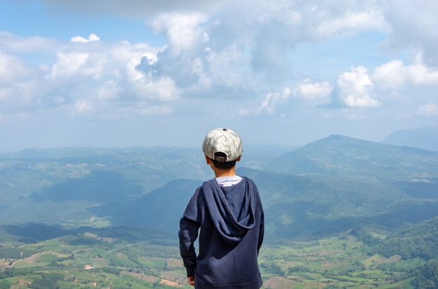 Asian boys see the mountains and the sky at phu rua national park in loei.