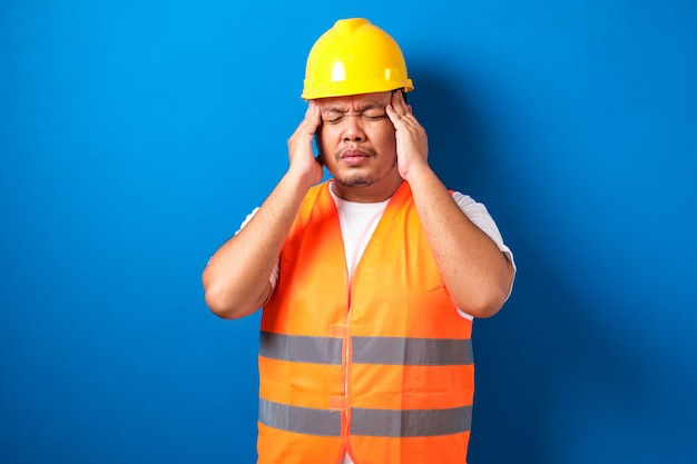 Asian builder man wearing construction uniform and safety helmet isolated