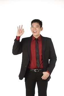 Asian business man give hand gesture ok