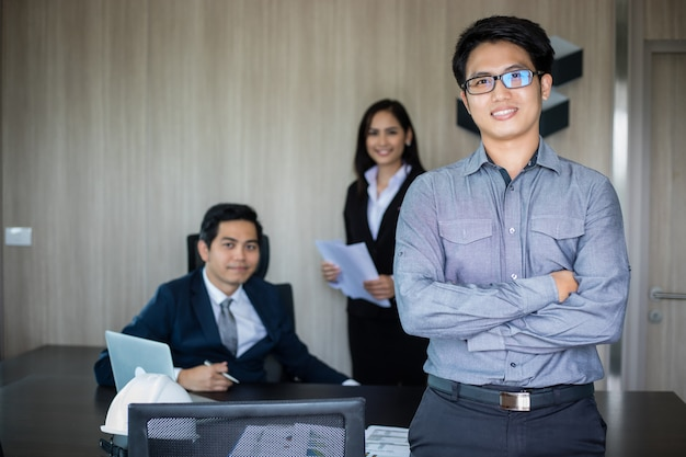 Asian business man and group using notebook for meeting and business men smiling happy for working