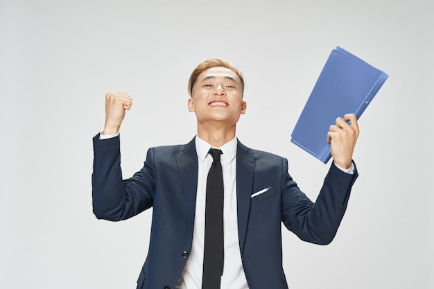 Asian business man posing in suit in studio