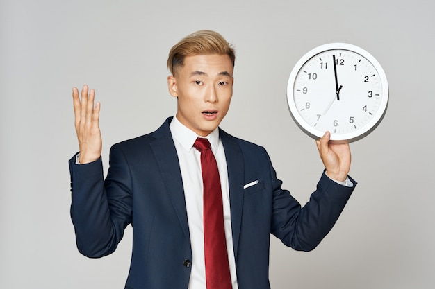 Asian business man posing in suit in studio