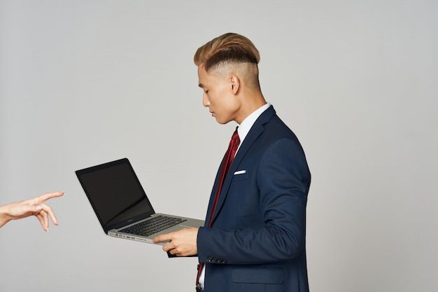 Asian business man posing in suit