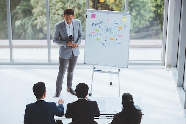 Asian business men trainer giving presentation