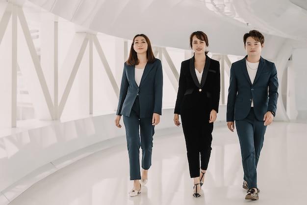 Asian business team is walking