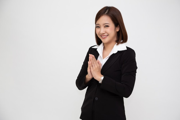 Asian business woman in black suit greeting action thai style.