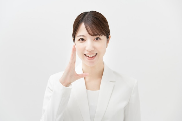 Asian business woman in a cheering pose with smile