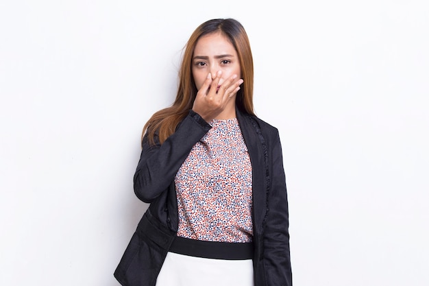 Asian business woman holding her nose because of a bad smell