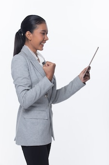 Asian business woman stand in gray formal suit