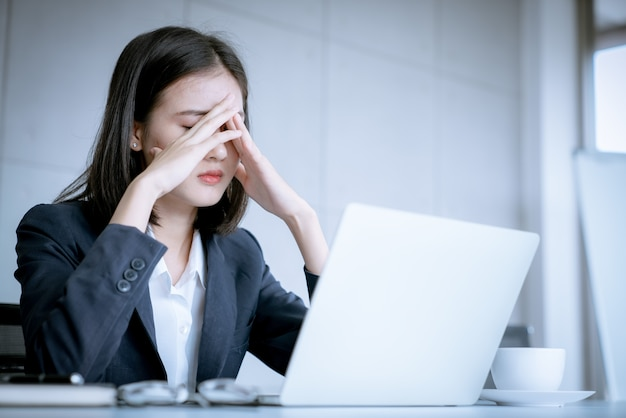 Asian business woman stress because work mistake to be risk for fired