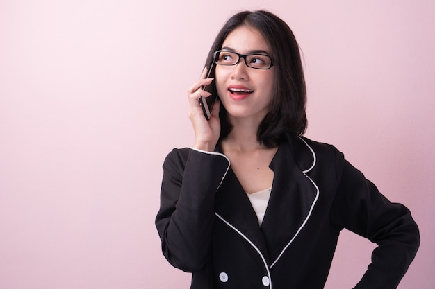 Asian business woman talking on mobile phone.
