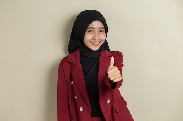 Asian business woman wearing hijab with hand thumbs up okay