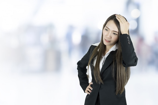 Asian business woman with headache.