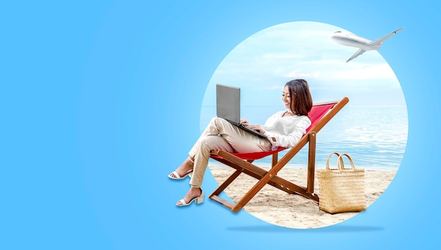 Asian business woman working with laptop sitting in the beach chair
