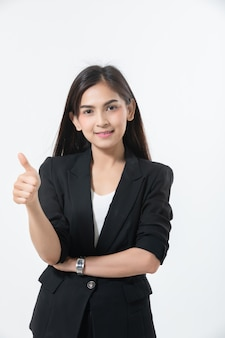 Asian business women are smiling and thump up hand sign for working happy and success and winning