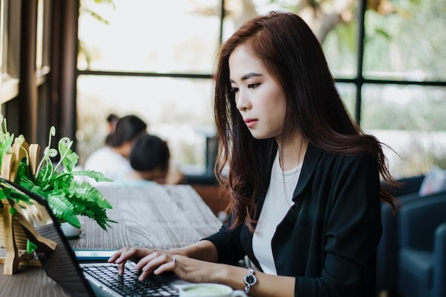 Asian business women using notebook for working