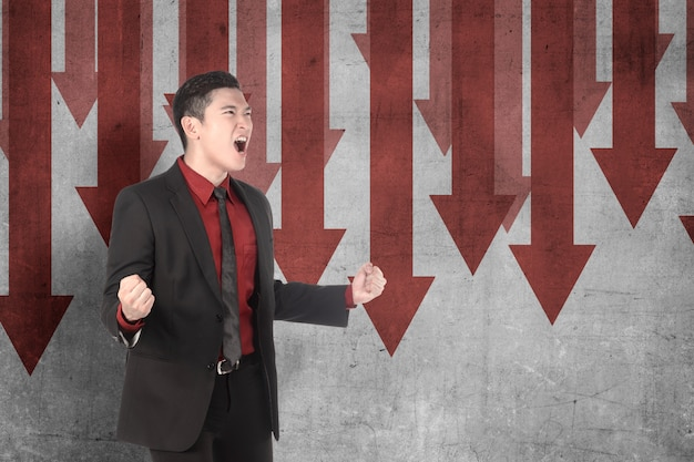 Asian businessman feeling depressed with global economic impact