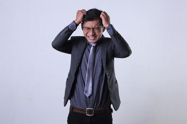 An asian businessman having stressful