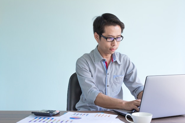 Asian businessman is working in office