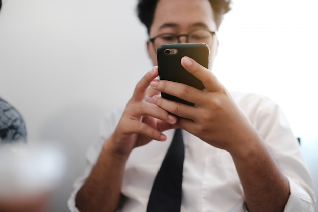 Asian businessman looking at smartphone